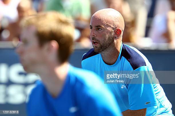Jamie Delgado of Great Britain and Jonathan Marray of Great Britain look on during play against Matthias Bachinger of Germany and Philipp...