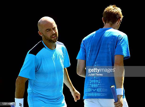 Jamie Delgado of Great Britain and Jonathan Marray of Great Britain react to a play against Matthias Bachinger of Germany and Philipp Kohlschreiber...