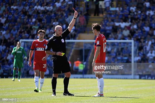 Jamie Devitt of Carlisle United is shown a red card during the Sky Bet League Two match between Portsmouth and Carlisle United at Fratton Park on...