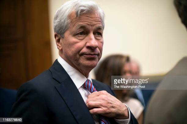 Jamie Dimon, Chair and CEO of JP Morgan Chase, takes his seat to testify before the House Financial Services Commitee in Washington Wednesday April...