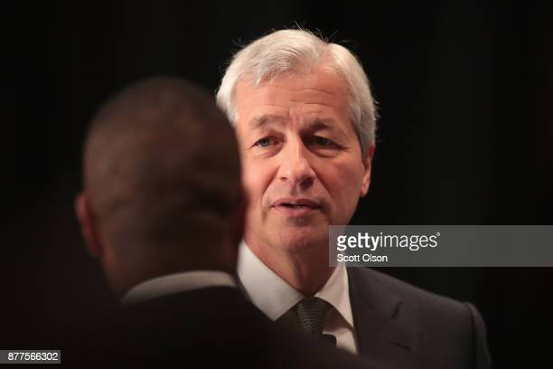 Jamie Dimon Chairman and CEO of JPMorgan Chase Co greets guests after speaking at a luncheon hosted by The Economic Club of Chicago on November 22...