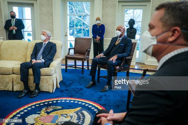 Jamie Dimon, Chairman and CEO of JPMorgan Chase, Marvin Ellison, President and CEO of Lowe's Companies and Doug McMillon look on as President Joe...