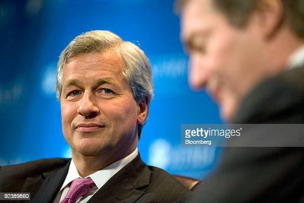 Jamie Dimon chairman and chief executive officer of JP Morgan Chase Co left speaks with broadcaster Charlie Rose at the annual meeting of the...