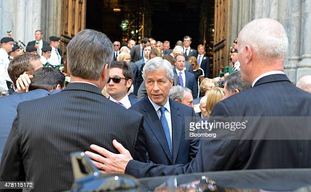 Jamie Dimon chairman and chief executive officer of JPMorgan Chase Co greets attendees outside St Patrick's Cathedral in New York US on June 22 2015...