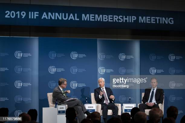 Jamie Dimon, chief executive officer of JPMorgan Chase & Co., center, speaks while Tim Adams, president and chief executive officer of the Institute...