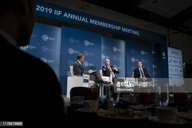 Jamie Dimon chief executive officer of JPMorgan Chase Co center speaks while Tim Adams president and chief executive officer of the Institute of...