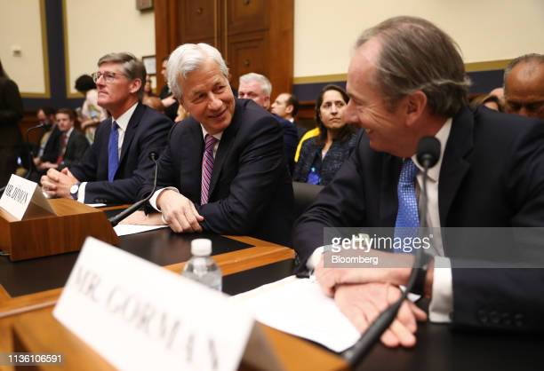 Jamie Dimon chief executive officer of JPMorgan Chase Co center speaks with James Gorman chief executive officer of Morgan Stanley right before the...