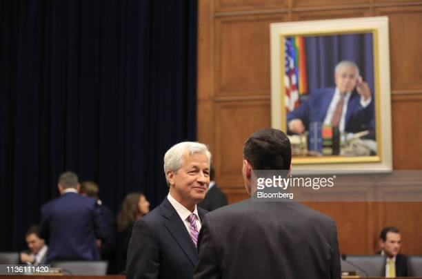Jamie Dimon chief executive officer of JPMorgan Chase Co left speaks with a lawmaker before the start of a House Financial Services Committee hearing...