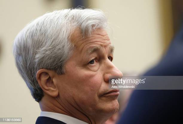 Jamie Dimon, chief executive officer of JPMorgan Chase & Co., listens while at a House Financial Services Committee hearing on April 10, 2019 in...