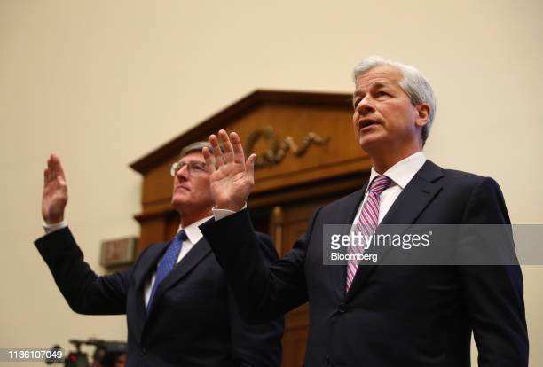 Jamie Dimon chief executive officer of JPMorgan Chase Co right and Michael Corbat chief executive officer of Citigroup Inc are sworn into a House...