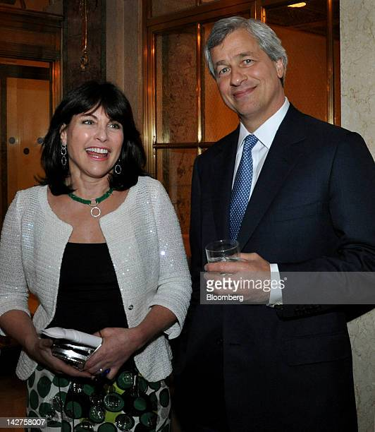 Jamie Dimon chief executive officer of JPMorgan Chase Co right and wife Judy Dimon stand for a photograph at the KiDS of NYU gala in New York US on...