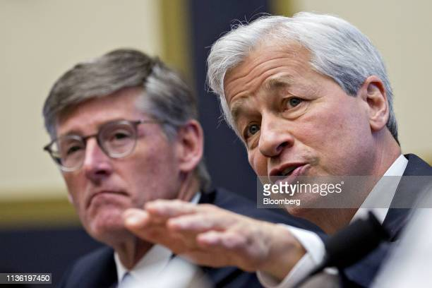 Jamie Dimon chief executive officer of JPMorgan Chase Co speaks as Michael Corbat chief executive officer of Citigroup Inc left listens during a...