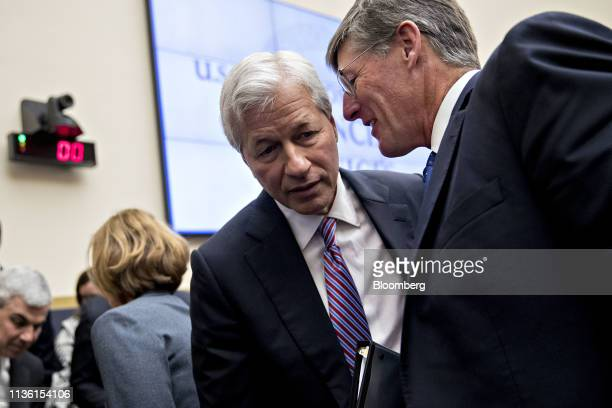 Jamie Dimon, chief executive officer of JPMorgan Chase & Co., talks to Michael Corbat, chief executive officer of Citigroup Inc., right, during a...