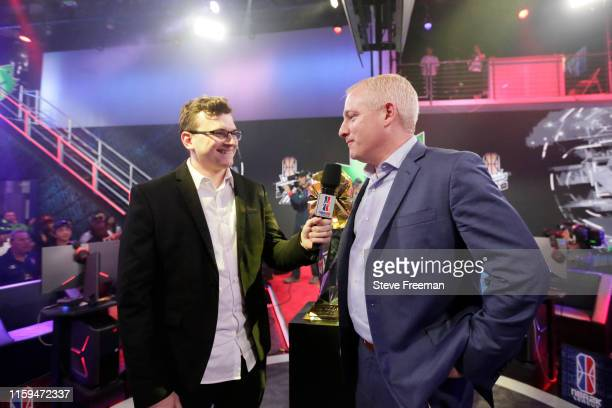 Jamie Dirk Diaz Ruiz speaks with NBA 2K League Managing Director Brendan Donahue after Game Five of the NBA 2K League Finals on August 3 2019 at the...