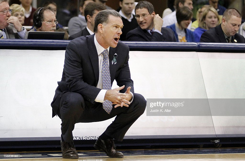 Jamie Dixon of the Pittsburgh Panthers argues a call from the bench against the Cincinnati Bearcats during the game at Petersen Events Center on December 31, 2012 in Pittsburgh, Pennsylvania. Cincinnati defeated Pittsburgh 70-61.