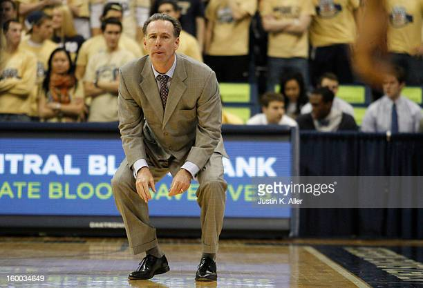 Jamie Dixon PITT head coach looks on from the bench against the Connecticut Huskies at Petersen Events Center on January 19, 2013 in Pittsburgh,...