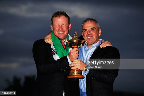 Jamie Donaldson and Europe team captain Paul McGinley pose with the Ryder Cup trophy after the Singles Matches of the 2014 Ryder Cup on the PGA...