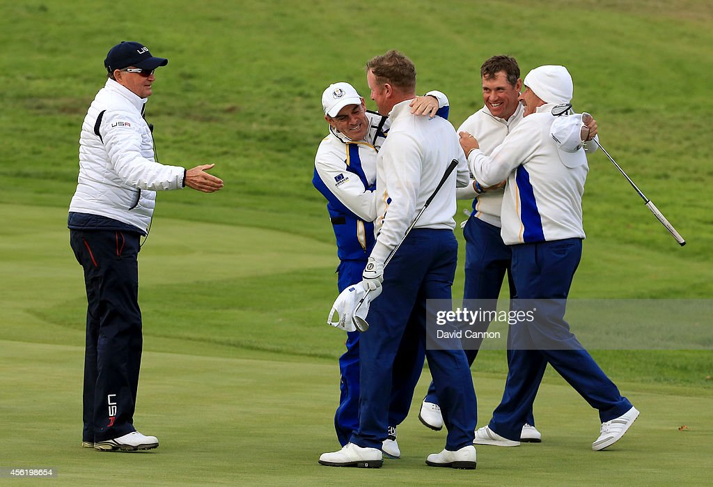 Jamie Donaldson and Lee Westwood of Europe are congratulated by Europe team captain Paul McGinley and vice captain Sam Torrance after their victory on the 17th green during the Afternoon Foursomes of the 2014 Ryder Cup on the PGA Centenary course at the Gleneagles Hotel on September 27, 2014 in Auchterarder, Scotland.