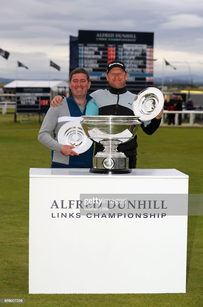 Jamie Donaldson & Kieran McManus celebrate victory in the PRO-AM event following the final round of the 2017 Alfred Dunhill Championship at The Old Course on October 8, 2017 in St Andrews, Scotland.