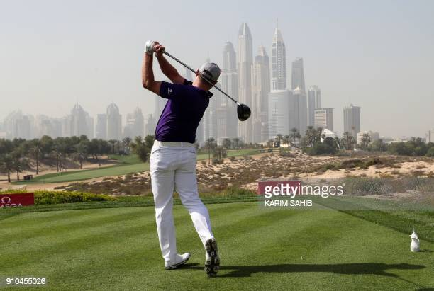 Jamie Donaldson of England plays a shot during the round two of the Dubai Desert Classic at Emirates Golf Club on January 26 2018 in Dubai / AFP...