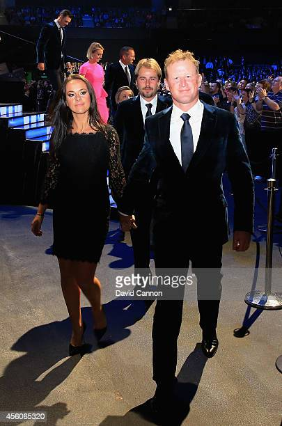 Jamie Donaldson of Europe and partner Kathryn Tagg leave the stage during the 2014 Ryder Cup Gala Concert at the SSE Hydro on September 24 2014 in...