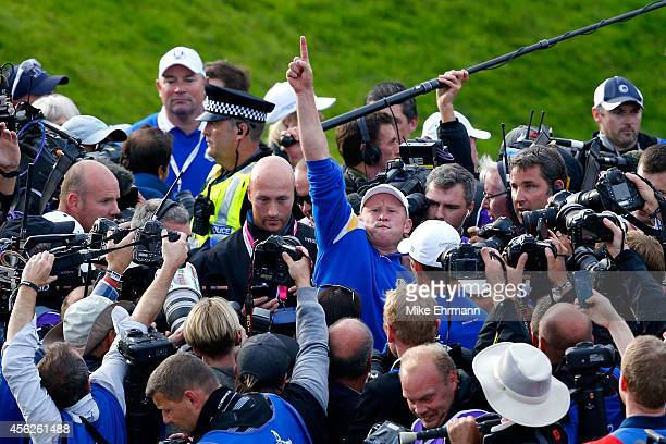 Jamie Donaldson of Europe celebrates on the 15th hole after Europe won the Ryder Cup with Donaldson defeating Keegan Bradley of the United States...