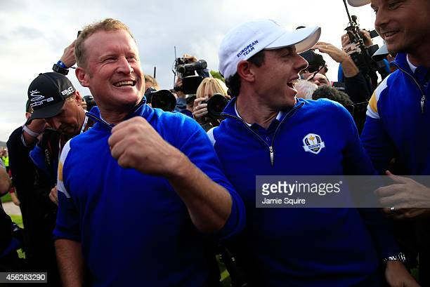 Jamie Donaldson of Europe celebrates on the 15th hole with Rory McIlroy after Europe won the Ryder Cup with Donaldson defeating Keegan Bradley of the...