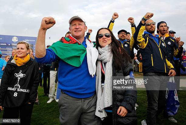 Jamie Donaldson of Europe celebrates winning the Ryder Cup with partner Kathryn Tagg during the Singles Matches of the 2014 Ryder Cup on the PGA...