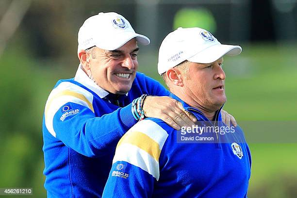 Jamie Donaldson of Europe is congratulated by Europe team captain Paul McGinley on the 15th hole shortly before Europe won the Ryder Cup after...