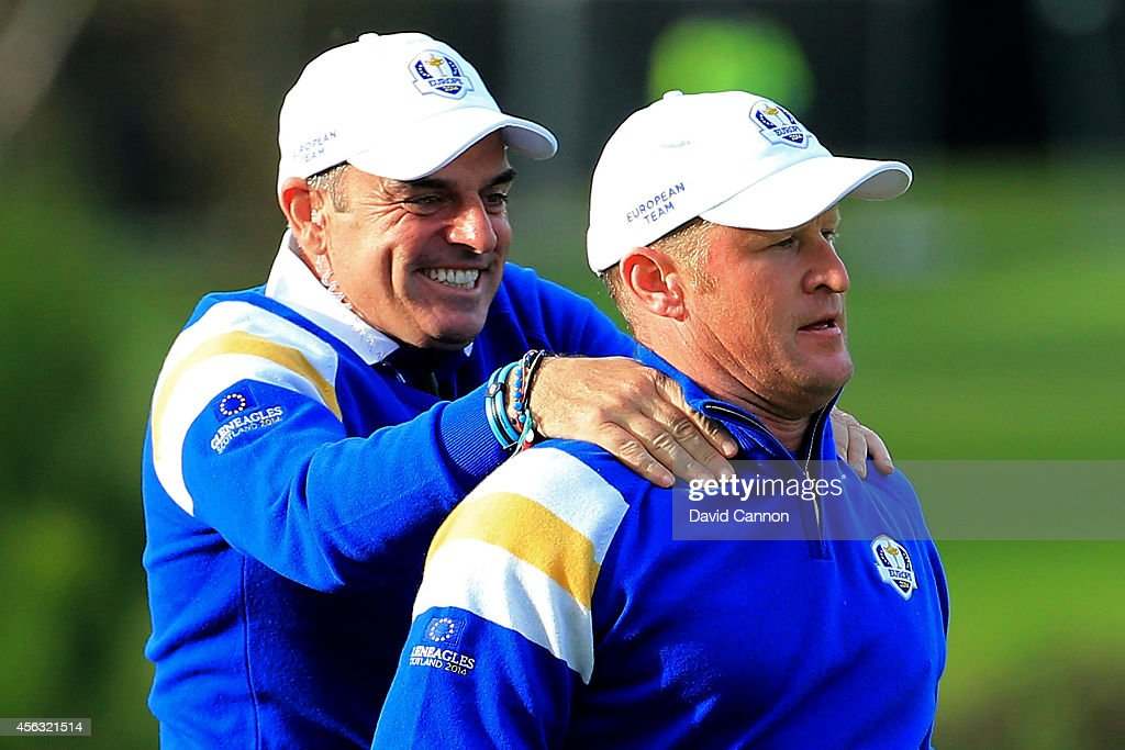 Jamie Donaldson of Europe is congratulated by Europe team captain Paul McGinley on the 15th hole shortly before Europe won the Ryder Cup after Donaldson defeated Keegan Bradley of the United States during the Singles Matches of the 2014 Ryder Cup on the PGA Centenary course at the Gleneagles Hotel on September 28, 2014 in Auchterarder, Scotland.