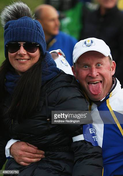 Jamie Donaldson of Europe sticks out his tongue with Kathryn Tagg after the Afternoon Foursomes of the 2014 Ryder Cup on the PGA Centenary course at...