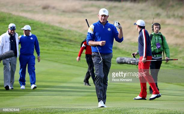Jamie Donaldson of Europe walks down the 15th fairway shortly before Europe won the Ryder Cup after Donaldson defeated Keegan Bradley of the United...