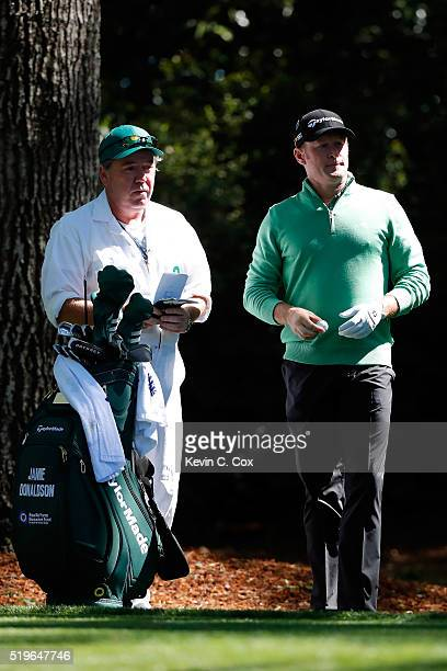 Jamie Donaldson of Wales and caddie Michael Mick Donaghy prepares to play from the second tee during the first round of the 2016 Masters Tournament...