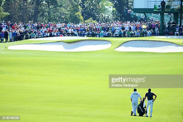 Jamie Donaldson of Wales and his caddie Michael Donaghy stand in a fairway during a practice round prior to the start of the 2016 Masters Tournament...