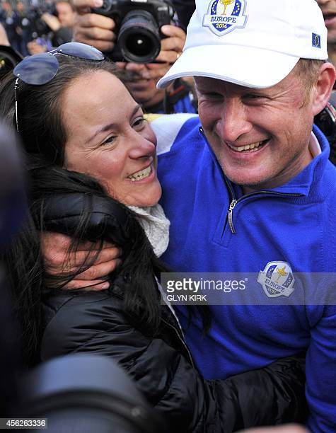 Jamie Donaldson of Wales and his partner Kathryn Tagg celebrate after Europe won the 2014 Ryder Cup at Gleneagles in Scotland on September 28 during...