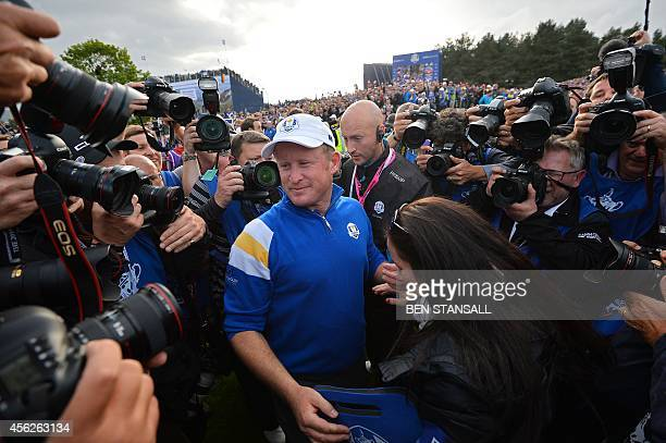 Jamie Donaldson of Wales celebrates with his fiancee Kathryn Tagg on the 15th green after winning the Ryder Cup for Team Europe during Sunday's...