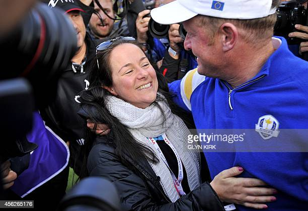 Jamie Donaldson of Wales celebrates with his partner Kathryn Tagg after Europe won the 2014 Ryder Cup at Gleneagles in Scotland on September 28...