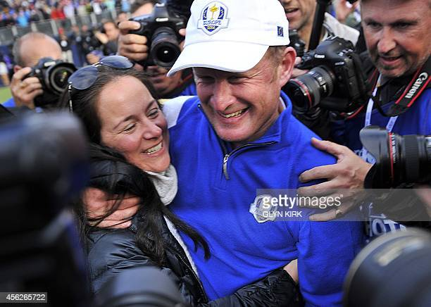 Jamie Donaldson of Wales celebrates with his wife Kathryn Tagg after Europe won the 2014 Ryder Cup at Gleneagles in Scotland on September 28 during...