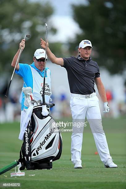 Jamie Donaldson of Wales decides on his club for his tee shot on the par 3 fifth hole with his caddie Mick Donaghyduring the first round of The Honda...