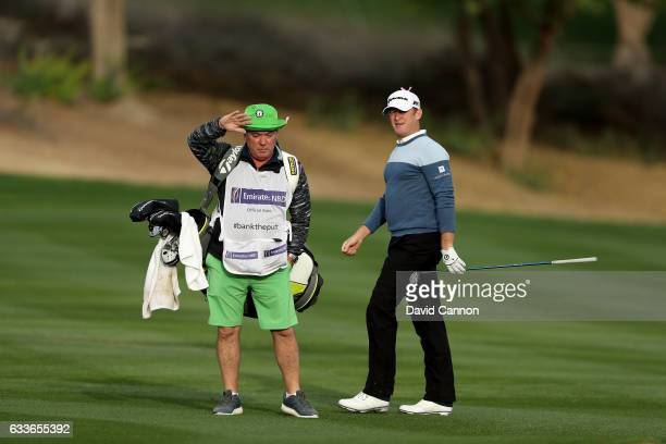 Jamie Donaldson of Wales follows his second shot on the third hole with his caddie Mick Donaghy during the second round of the 2017 Omega Dubai...