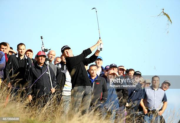 Jamie Donaldson of Wales hacks out of the rough on the 2nd during his first round match against Patrick Reed of the USA at the Volvo World Matchplay...