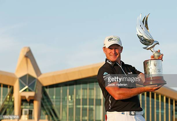 Jamie Donaldson of Wales kisses the trophy after winning the Abu Dhabi HSBC Golf Championship at Abu Dhabi Golf Club on January 20 2013 in Abu Dhabi...