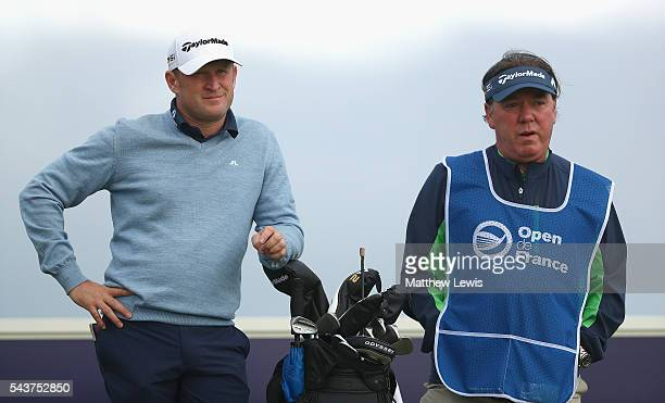 Jamie Donaldson of Wales looks on with his caddie Michael 'Mick' Donaghy during day one of the 100th Open de France at Le Golf National on June 30...