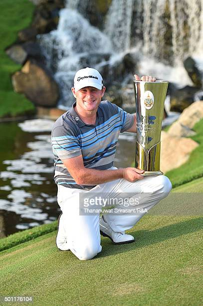 Jamie Donaldson of Wales pose with the trophy after winning the final round of the 2015 Thailand Open at Amata Spring Country Club on December 13...