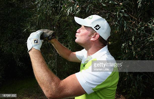 Jamie Donaldson of Wales poses with a tortosie during the proam as a preview for the Turkish Airlines Open at Montgomerie Maxx Royal Course on...