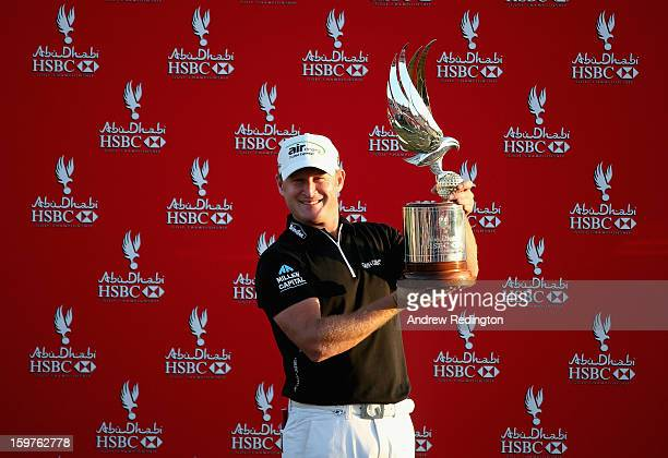 Jamie Donaldson of Wales poses with the trophy after winning The Abu Dhabi HSBC Golf Championship at Abu Dhabi Golf Club on January 20 2013 in Abu...