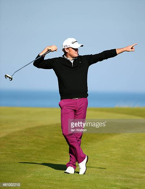 Jamie Donaldson of Wales reacts after putting on the 15th green during the second round of the 2015 Alfred Dunhill Links Championship at the...