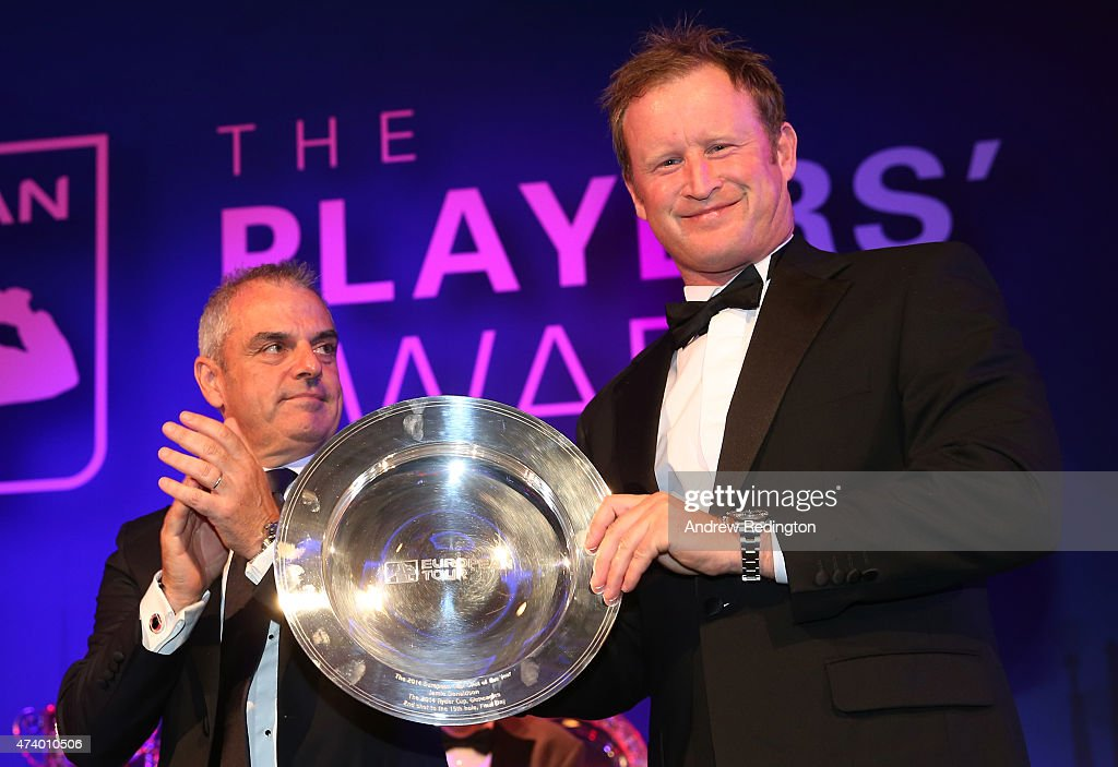 Jamie Donaldson of Wales receives the Shot of the Year award from Paul McGinley of Ireland during the European Tour Players' Awards ahead of the BMW PGA Championship at the Sofitel London Heathrow on May 19, 2015 in London, England.