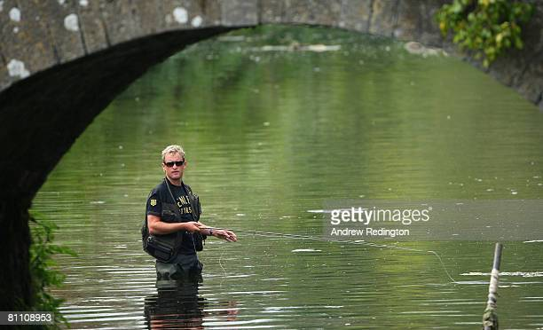 Jamie Donaldson of Wales trys his hand at fishing after the second round of the Irish Open on May 16 2008 at the Adare Manor Hotel and Golf Resort in...