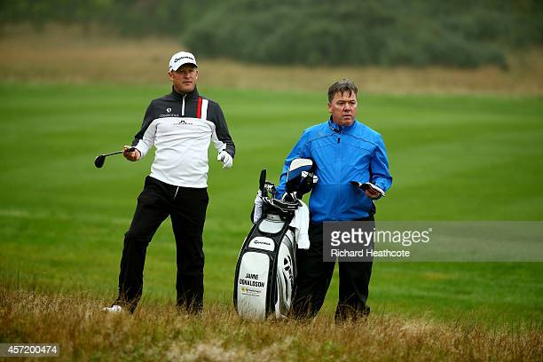 Jamie Donaldson of Wales with caddy Mick Donaghy during the proam for the Volvo World Matchplay at The London Club on October 14 2014 in Ash England